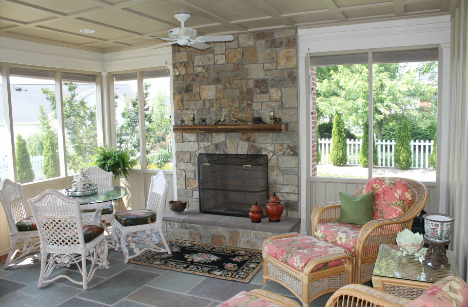 Outdoor ceiling fans  provide both lighting and air movement on a screen porch.